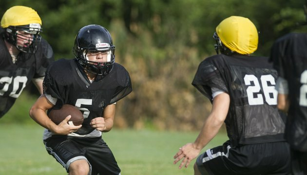 miners-running-back-estevan-padillo-5-looks-for-yardage-during-fall-practice-at-bauxite-high-school