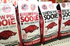 """NWA Media/ANDY SHUPE A coffee roaster in Rogers is packaging """"Brew Pig Sooie"""" coffees Thursday, Aug. 22, 2013, on the shelves at the Walmart Supercenter on Martin Luther King Jr. Boulevard in Fayetteville."""