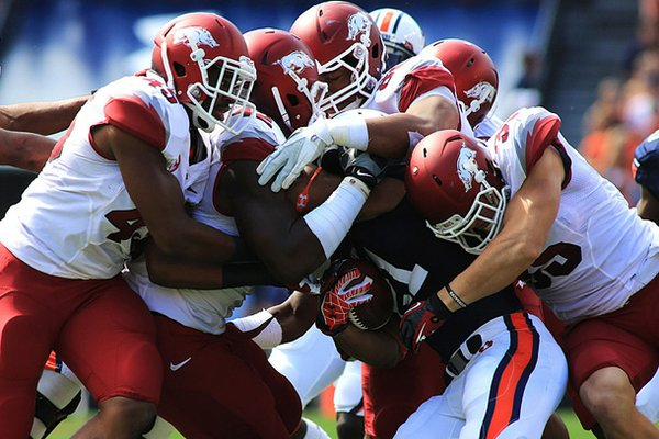 The Arkansas defense swarms Auburn running back Tre Mason in the Razorbacks' game against Auburn at Jordan-Hare Stadium in 2012. The Razorbacks host the Tigers on Nov. 2 this season.