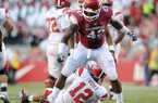 Arkansas defensive end Chris Smith (42) heads up a defensive line that is expected to be the strength of a defense that will have to play better if Arkansas hopes to improve on last season's 4-8 collapse.