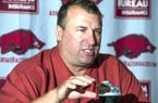 Arkansas head coach Bret Bielema answers a question during media day in Fayetteville, Ark., Sunday, Aug. 11, 2013. Bielema is in his first year as head coach for the team. (AP Photo/April L. Brown)
