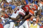 Florida defensive back Marcus Roberson (5) breaks up a pass intended for Louisiana-Lafayette wide receiver Jamal Robinson (15) during the second half of an NCAA college football game in Gainesville, Fla., Saturday, Nov. 10, 2012. Florida won 27-20. (AP Photo/Phil Sandlin)