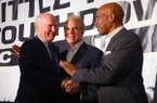 Cliff Harris, left, greets Roger Staubach, center, and Drew Pearson, right, after taking the stage at the Little Rock Touchdown Club meeting Monday in Little Rock.