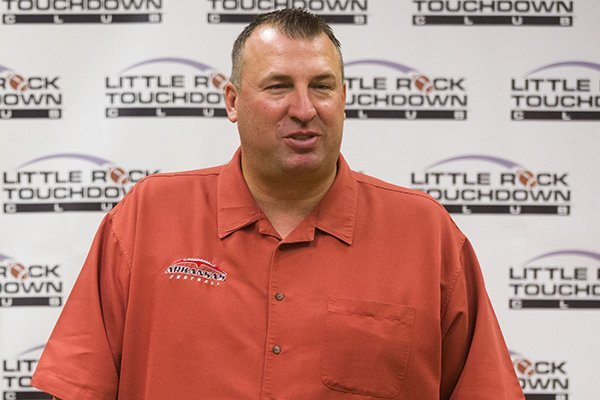 Arkansas football coach Bret Bielema speaks to media before The Little Rock Touchdown Club's first meeting of the season August 21, 2013 at the Marriot in Little Rock.