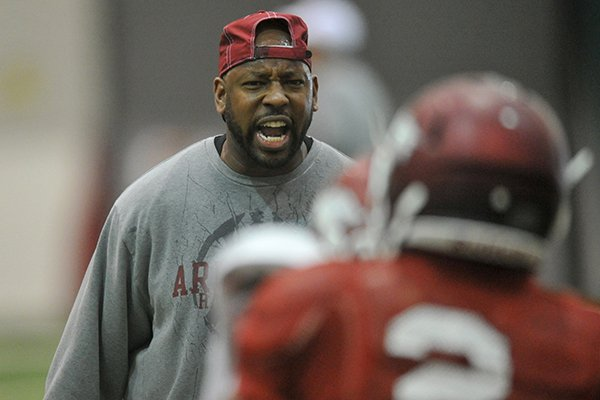 University of Arkansas assistant coach Taver Johnson works with his team during practice in Fayetteville.