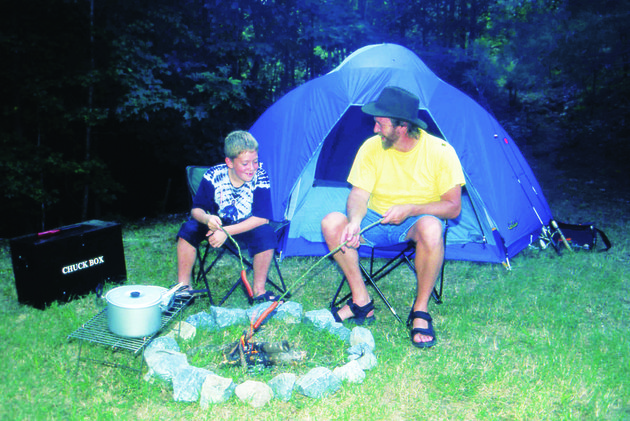 cooking-hot-dogs-on-a-stick-is-a-fun-method-of-camp-cooking-but-kids-will-also-enjoy-ice-cream-made-in-a-tin-can-and-breakfast-cooked-in-a-paper-sack
