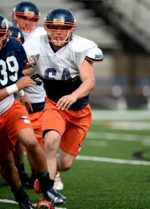 Rogers Heritage senior offensive lineman Hunter Chasteen practices on Friday, Aug. 9, 2013, at Gates Stadium in Rogers.