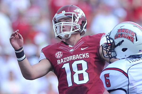 University of Arkansas kicker Zach Hocker watches his kick in the first quarter of Saturday's game against Louisiana-Lafayette at Razorback Stadium in Fayetteville.