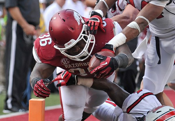 Arkansas fullback Kiero Small pushes ...