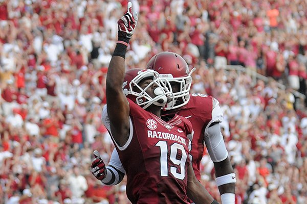 Arkansas receiver Javontee Herndon celebrates after catching a 49-yard touchdown pass from Brandon Allen in the second quarter of the Razorbacks' 34-14 win over Louisiana-Lafayette on Saturday, Aug. 31, 2013 at Razorback Stadium in Fayetteville.