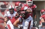 Arkansas running back Jonathan Williams tries to shake off a group of defenders during Saturday afternoon's game against the Louisiana-Lafayette Ragin' Cajuns at Razorback Stadium in Fayetteville.