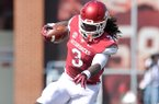 University of Arkansas running back Alex Collins tries to shake a defender during Saturday afternoon's game against the Louisiana-Lafayette Ragin' Cajuns at Razorback Stadium in Fayetteville.
