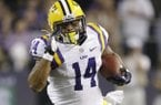 LSU running back Terrence Magee (14) runs for a touchdown against TCU during the second half of an NCAA college football game Saturday, Aug. 31, 2013, in Arlington, Texas. (AP Photo/LM Otero)