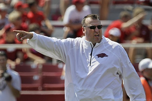 Arkansas coach Bret Bielema gestures during warm-ups before an NCAA college football game against Louisiana-Lafayette in Fayetteville, Ark., Saturday, Aug. 31, 2013. (AP Photo/Danny Johnston)
