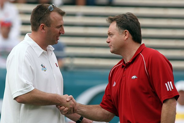 Arkansas coach Houston Nutt and Wisconsin coach Bret Bielema shake hands prior to the Capital One Bowl in Orlando on Jan. 1, 2007.