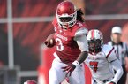 Arkansas running back Alex Collins runs for a gain during the first quarter of the Razorbacks' 34-14 win over Louisiana-Lafayette on Saturday, Aug. 31, 2013 at Razorback Stadium in Fayetteville.