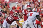 Arkansas defenders Trey Flowers (left) and Deatrich Wise Jr, put the pressure on the quarterback during Saturday afternoon's game against Louisiana-Lafayette at Razorback Stadium in Fayetteville.