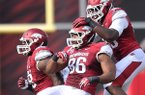 Arkansas defenders (left to right) Robert Thomas, Trey Flowers and Brandon Lewis celebrate after a turnover during Saturday afternoon's game against Louisiana-Lafayette at Razorback Stadium in Fayetteville.