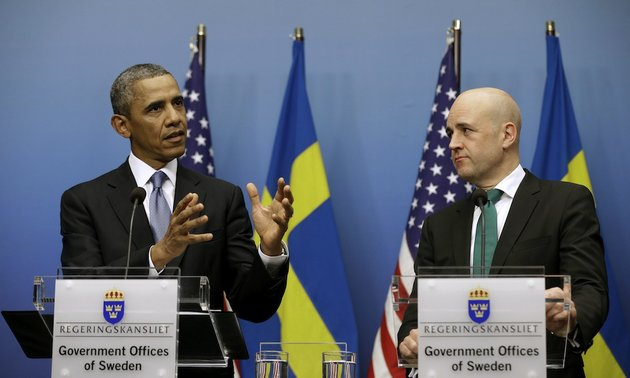 president-barack-obama-accompanied-by-swedish-prime-minister-fredrik-reinfeldt-gestures-during-their-joint-news-conference-at-the-rosenbad-building-wednesday-sept-4-2013-in-stockholm-sweden