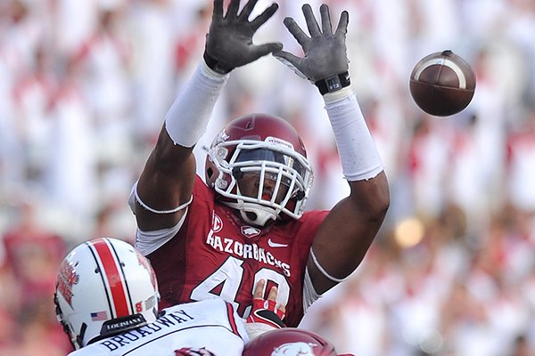 Arkansas defensive end Deatrich Wise Jr. tries to deflect a pass during the Razorbacks' 34-14 win over Louisiana-Lafayette on Saturday, Aug. 31, 2013 at Razorback Stadium in Fayetteville.