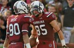 South Carolina wide receiver Kane Whitehurst (85) celebrates with teammate wide receiver K.J. Brent (80) after scoring a touchdown during the first half of an NCAA college football game against North Carolina, Thursday, Aug. 29, 2013, in Columbia, S.C. (AP Photo/Stephen Morton)