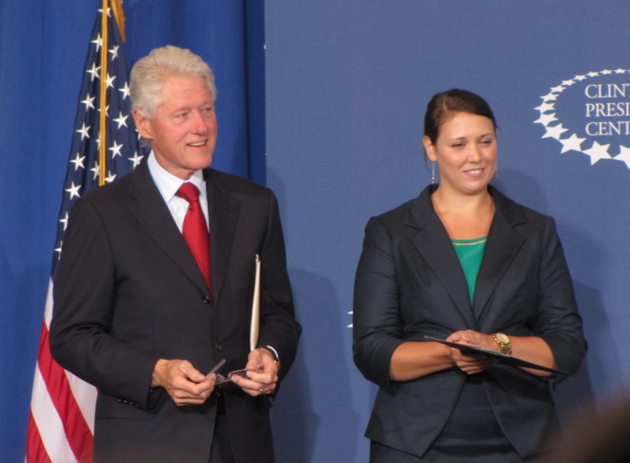 bill-clinton-stands-on-stage-with-clinton-school-student-body-president-mara-damico-wednesday-in-little-rock