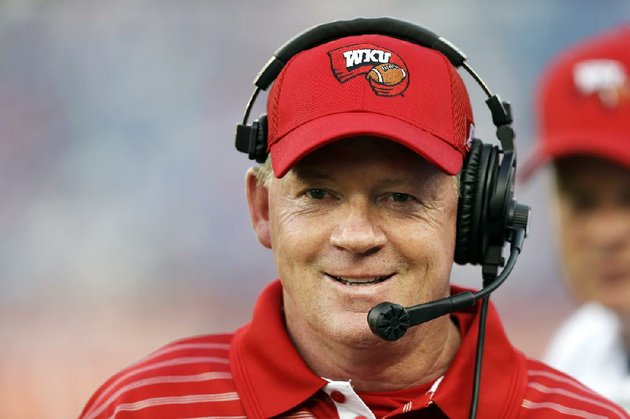 western-kentucky-head-coach-bobby-petrino-watches-from-the-sideline-in-the-first-quarter-of-an-ncaa-college-football-game-against-kentucky-on-saturday-aug-31-2013-in-nashville-tenn-ap-photomark-humphrey