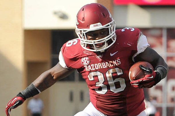 Arkansas fullback Kiero Small runs for a touchdown against Louisiana-Lafayette on Saturday, August 31, at Donald W. Reynolds Razorback Stadium.