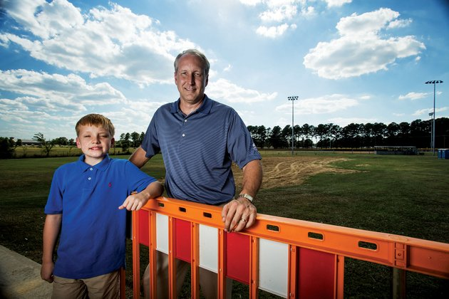 above-david-grimes-and-his-son-john-david-stand-at-the-location-of-a-future-miracle-league-baseball-field-in-conway-the-site-is-also-proposed-to-include-a-handicapped-accessible-playground