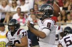 Samford quarterback Andy Summerlin (8) passes during the first quarter of an NCAA college football game against Arkansas in Little Rock, Ark., Saturday, Sept. 7, 2013. (AP Photo/Danny Johnston)