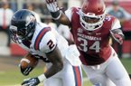 Samford running back Fabian Truss (2) is tackled by Arkansas linebacker Braylon Mitchell (34) during first half of an NCAA college football game in Little Rock, Ark., Saturday, Sept. 7, 2013. (AP Photo/David Quinn)