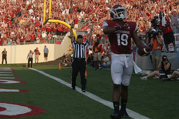 Arkansas Razorbacks' Javontee Herndon celebrates his touchdown in the end zone in the second quarter against Samford Bulldogs during their game September 7, 2013 at War Memorial Stadium.