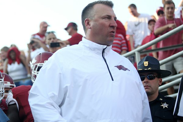 Arkansas coach Bret Bielema leaves the tunnel with the Razorbacks in their game against Samford at War Memorial Stadium September 7, 2013.