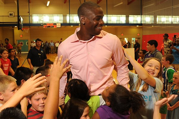 Houston Rockets forward Ronnie Brewer interacts with children at the Boys & Girls Club of Fayetteville on Monday, Sept. 9, 2013.
