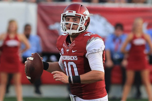 Arkansas quarterback Brandon Allen looks for an open receiver during the first quarter of the Razorbacks' 31-21 win over Samford on Saturday, Sept. 7, 2013 at War Memorial Stadium in Little Rock.