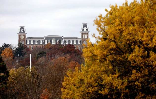 file-old-main-is-seen-over-the-treetops-on-the-university-of-arkansas-campus-in-fayetteville
