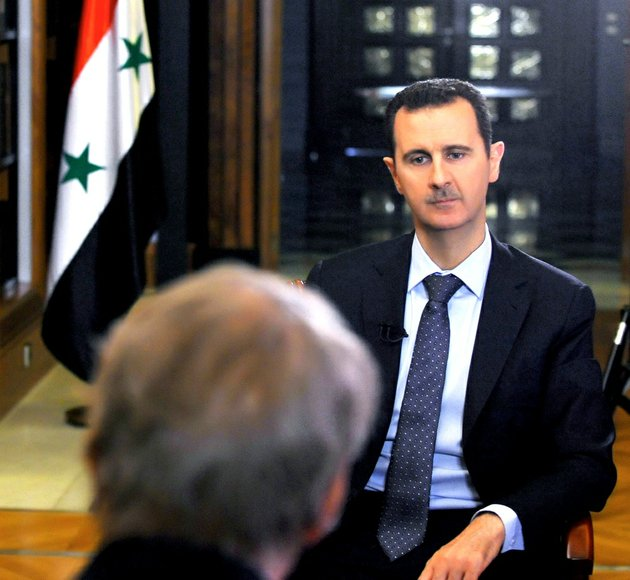 in-this-sunday-sept-8-2013-photo-released-by-the-syrian-official-news-agency-sana-pbs-host-charlie-rose-foreground-interviews-syrian-president-bashar-assad-at-the-presidential-palace-in-damascus-syria