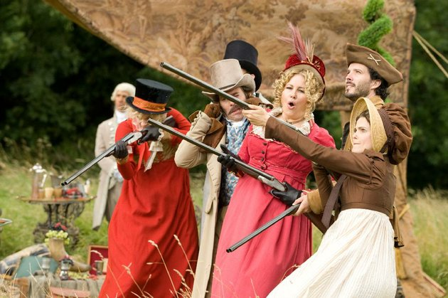 they-aim-to-please-at-austenland-the-fictional-british-theme-resort-for-which-jerusha-hess-new-comedy-takes-its-name-on-the-firing-line-from-left-are-lady-amelia-heartwright-georgia-king-colonel-andrews-james-callis-lady-elizabeth-charming-jennifer-coolidge-martin-bret-mckenzie-and-jane-hayes-keri-russell