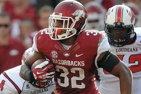 Jonathan Williams of Arkansas rushes down the field Saturday, Aug. 31, 2013 during the fourth quarter of the game against Louisiana-Lafayette at Donald W. Reynolds Razorback Stadium in Fayetteville.