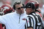Bret Bielema, Arkansas head coach, speaks to a referee Saturday, Aug. 31, 2013 during the first quarter of the game against Louisiana-Lafayette at Donald W. Reynolds Razorback Stadium in Fayetteville.