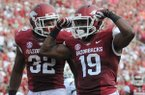 Arkansas receiver Javontee Herndon (19) reacts after catching a touchdown against Louisiana-Lafayette on Aug. 31, 2013 at Razorback Stadium in Fayetteville.
