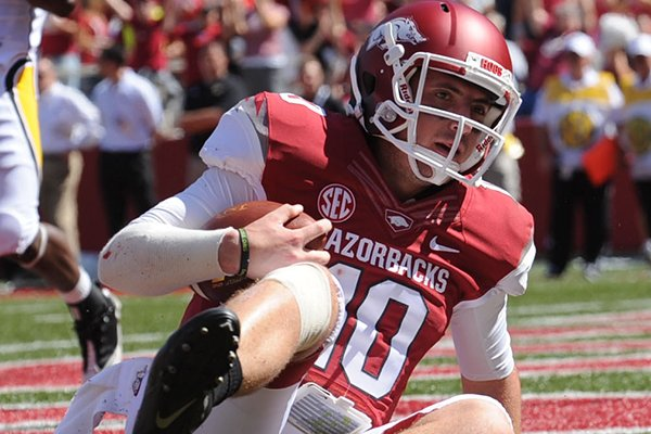 Arkansas quarterback Brandon Allen lies in the end zone after scoring a touchdown but injuring his shoulder Saturday, Sept. 14, 2013, during the first quarter of play at Razorback Stadium in Fayetteville.