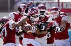 Arkansas teammates congratulate defensive end Trey Flowers after he intercepted a pass in the first quarter of the game against Southern Miss on Saturday September 14, 2013 at Razorbacks Stadium in Fayetteville.