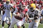 Arkansas quarterback Brandon Allen (10) runs past Southern Mississippi defensive lineman Dylan Bradley (94) for a touchdown during the first half of an NCAA college football game in Fayetteville, Ark., Saturday, Sept. 14, 2013. (AP Photo/April L. Brown)
