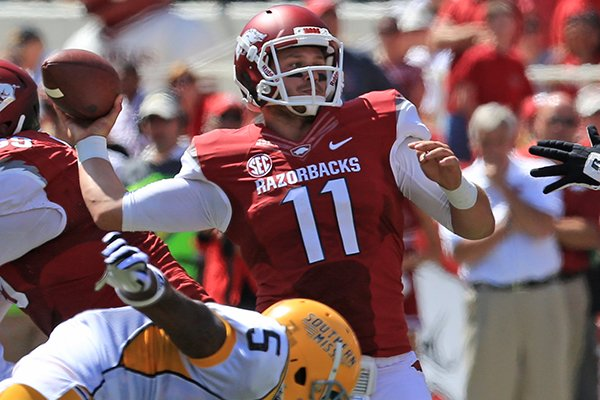 Arkansas' A.J. Derby (11) passes against Southern Miss in the 2nd quarter of their game Saturday at Reynolds Razorback Stadium in Fayetteville.