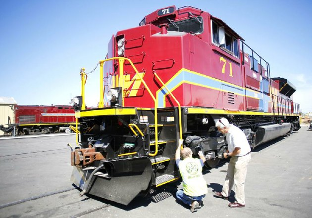 casey-shepherd-chief-mechanical-officer-at-arkansas-missouri-railroad-shows-chairman-reilly-mccarren-the-leaf-blowers-under-the-front-end-of-a-new-locomotive-the-railroad-bought-three-new-locomotives-the-first-in-27-years
