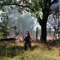 Firefighters at the scene of a July 24th fire at 11888 Malone Road.  The abandoned house was destroy...
