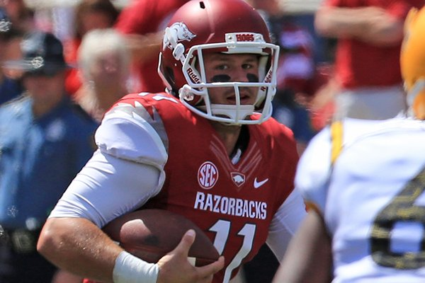 Arkansas' A.J. Derby (11) runs out of the pocket in the 2nd quarter of the game Saturday at Reynolds Razorback Stadium in Fayetteville.
