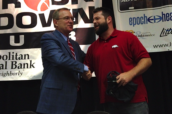 Arkansas Athletic Director Jeff Long greets a fan Monday following his address at the Little Rock Touchdown Club.