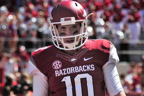 In this photo taken Sept. 14, 2013, Arkansas quarterback Brandon Allen walks from the end zone after scoring during the first quarter of an NCAA college football game against Southern Mississippi in Fayetteville, Ark. Allen was injured on the play and sat out the rest of the game. (AP Photo/April L. Brown)